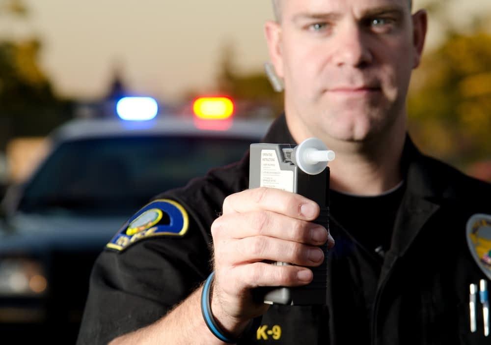 officer giving breathalyzer test