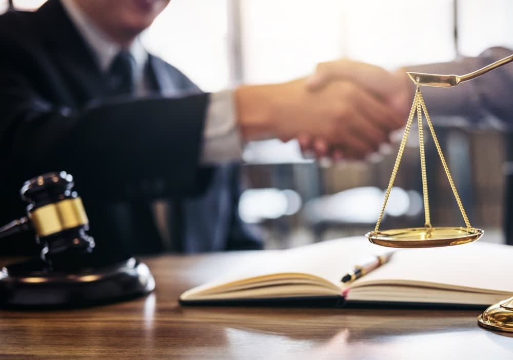 Handshake after drug crime win between lawyer and client