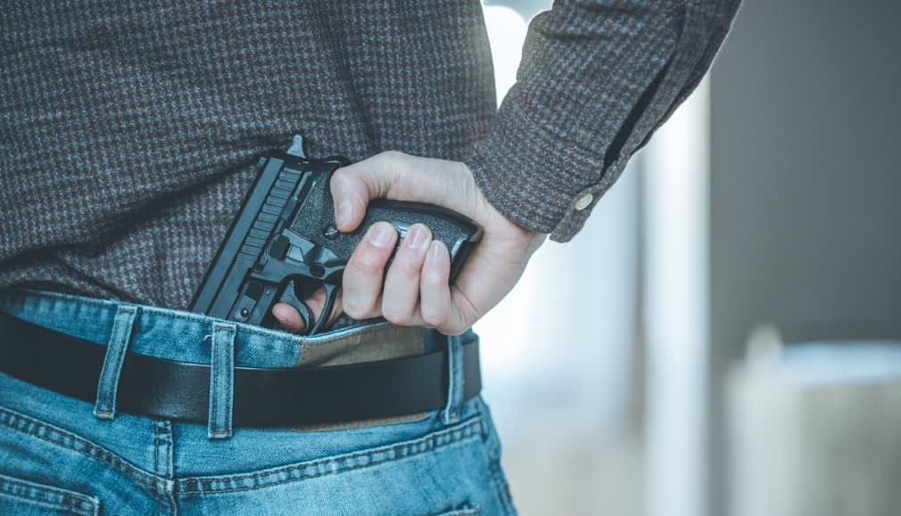 felon in possession of a firearm stock photo